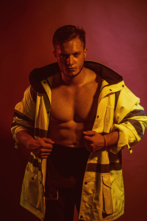 Construction worker or builder. Muscular man worker. Фото со стока