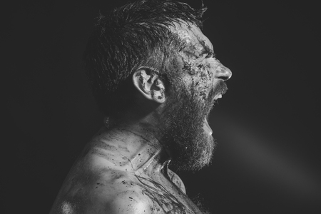 Hipster shout with bloody beard on brutal face profile Stock Photo