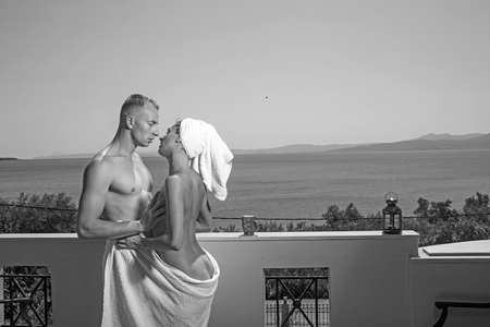Summer holidays and paradise travel vacation. Love relations of naked couple after shower. Couple in love with sexy body relax on balcony. Sexy woman and man in morning. Family and valentines day.