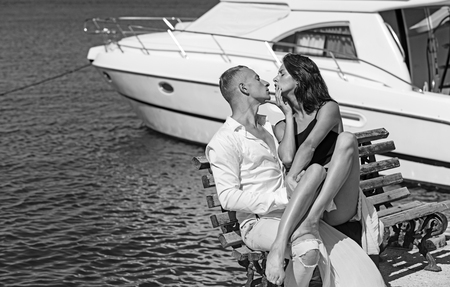 Summer holidays and travel vacation. Family and valentines day. Love relations of couple enjoying summer day together. Sexy woman and man at sea bay. Couple in love relax at yacht for marine travel Reklamní fotografie
