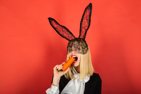 Happy young woman wearing bunny ears and having Easter Eggs. Smile easter.