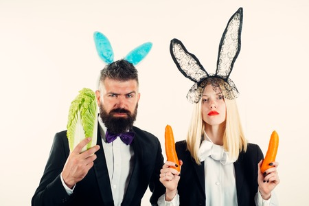 Happy easter and funny easter day. Funny easter bunny coupe. Two funny rabits. Funny couple in banny ears.