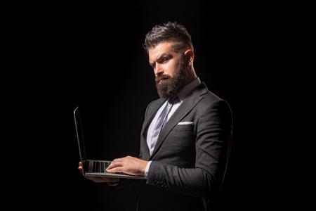 Business concept. Businessman in black suit portrait on black background. Job offer. Business confident.