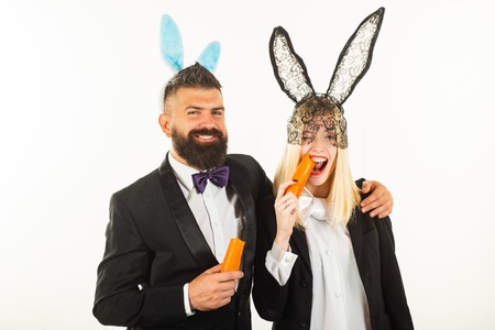 Happy easter and funny easter day. Bunny rabbit ears costume. Funny couple wearing bunny ears on Easter day. Stock Photo