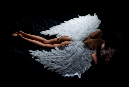 Romantic young beauty as an angel. Valentines Day symbol. Art photo of a Angelic beautiful woman. Angel girl.Cupid woman.