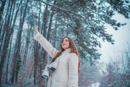 Winter woman snow. Christmas girl outdoor portrait. Winter woman happy.