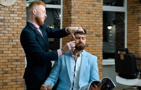 Sandalwood shaving cream. Barber shop. Bearded man. Making haircut look perfect in barber shop. Barber making haircut of attractive bearded man in barber shop. So trendy and stylish.