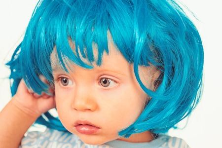 Pure beauty. Adorable little child in fashion wig. Small child wear blue wig hair. Small kid in fancy wig hairstyle. Cute baby with long blue hair. Beauty look hairstyle for cosplay party. Archivio Fotografico - 118685119