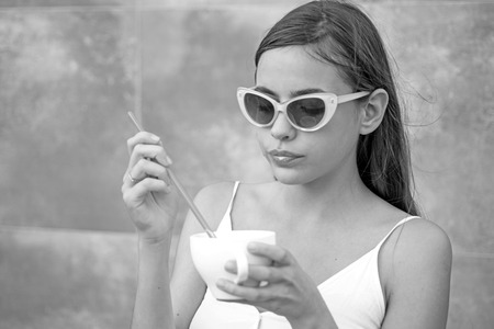 Start the day with great taste. Pretty woman sip beverage with drinking straw. Cute woman drink through straw in cafe. Fashionable woman enjoy sipping drink through straw. Savor the flavor. Imagens - 117843903
