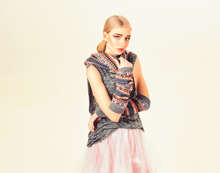 Blond model with bright make-up and thick eyebrows wearing boho style clothes isolated on white background 写真素材