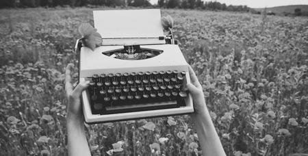 Vintage typewriter in hand, education, business, grammar.