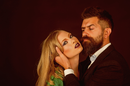 Keep the passion going. Fashion style and hair care. Style icons. They both love fashion. Couple in love. Bearded man hug woman with long hair. Intimate couple in fashion clothing