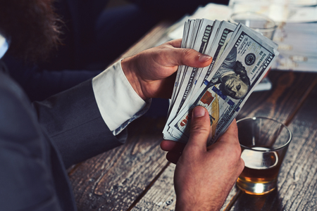 Funding project by raising monetary contributions. Hands counting us dollar banknotes. Cash money in hands of businessman. Paper money. American currency. Business and finance. Saving and banking