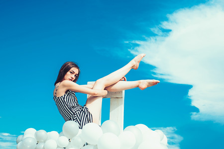 Fashion portrait of woman. woman in summer dress with party balloons. Stock Photo