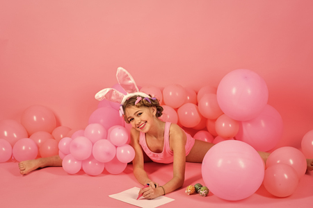 Small child with art and painting Easter eggs. Stock Photo