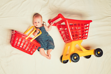 Childhood happiness. Big sale offer. Small girl go shopping. Sweet little baby. Stock Photo - 118696766