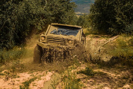 Jeep outdoors adventures. Off road sport truck between mountains landscape. Expedition offroader. 4x4 travel trekking. Best Off Road Vehicles. Rally racing.