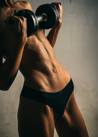 Fitness and attractive sporty girl. Girl with a perfect body