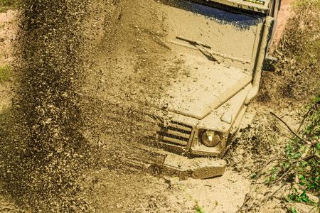 Track on mud. 4x4 Off-road suv car. Offroad car. Safari. Mud and water splash in off-road racing. 4x4 travel trekking. Best Off Road Vehicles. Rally racing. Stock Photo