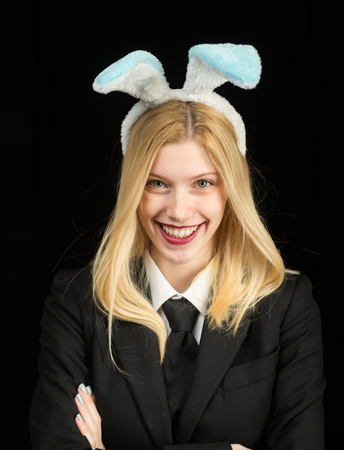 Closeup of winking bunny girl face. Blonde woman in rabbit bunny ears. Sweet lovely attractive adorable charming cheerful positive girl in bunny ears celebrating Easter.