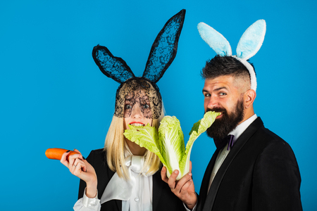 Happy Easter. Woman comic, funny and handsome man are wearing bunny ears. Easter sale concept. Copy space. Discount. Фото со стока