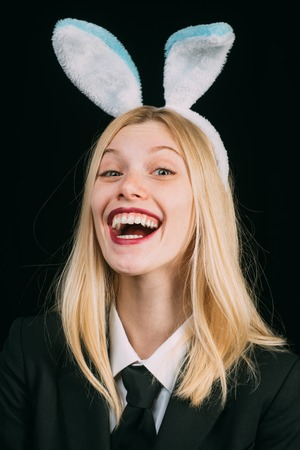 Woman in fashion Easter bunny mask. Happy woman in bunny ears with easter egg. Young girl easter woman in bunny ears. Stock Photo