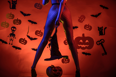 Womens clothing store celebrates Halloween. Sexy Horror background. Halloween sexy concept. Female with sexy ass posing. Sexy Model Posing In Lingerie on halloween background.