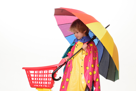 Little boy with rainbow-colored umbrella isolated on white background. Handsome little guy in preparing for Autumn. Sale for entire autumn collection, incredible discounts and wonderful choice.