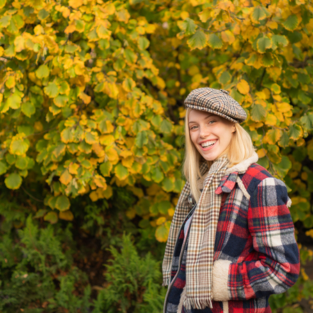 Woman wear checkered clothes nature background. Girl wear kepi. Fall fashion accessory. Adorable blonde fashion girl. Enjoy fall season. Autumn is here. Fashion trend. Pretty woman in hat. Fancy girl Stock fotó