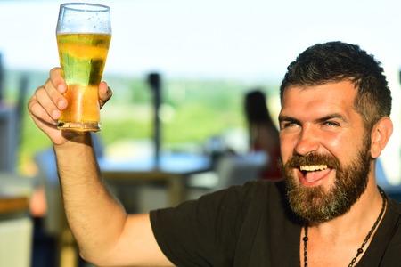 Beard man drinking beer from a beer mug. Man drinking beer. Man with beer.