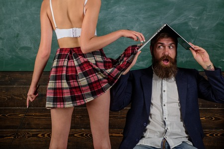 Sex education. Guy laptop erotic video. Man experienced bearded teacher and seductive female sexy buttocks. Learning sexy female body. Sexual life concept. Desirable student sexy legs. Sex role game