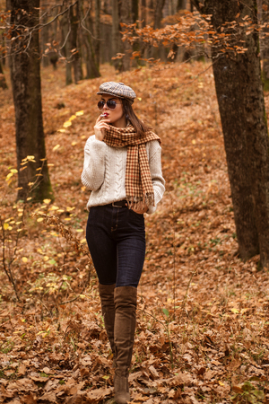 Relaxing smoking. Woman enjoy smoking alone. Lonely smoker. Autumn is here. Pretty woman in hat and sunglasses smoking cigarette forest background. Fall fashion accessory. Enjoy fall season