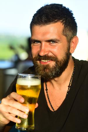 The celebration oktoberfest festival concept. Enjoy in pub. Handsome bearded man drinking beer.