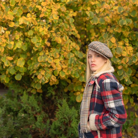 Pretty woman in hat. Woman wear checkered clothes nature background. Girl wear kepi. Fall fashion accessory. Adorable fashion girl. Enjoy fall season. Autumn is here. Fashion trend. Manly world