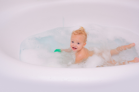 Health care and hygiene concept. Hygiene and care for young children. Child washing and bathing.