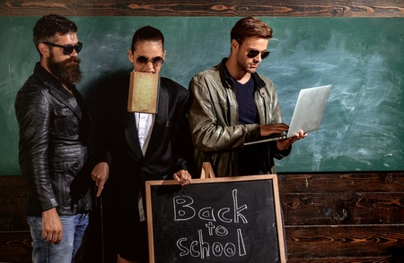 Girl formal jacket suit and guys sunglasses. Fashion trend. Stylish sunglasses accessory. School staff. People sunglasses in classroom. Woman men wear masculine clothes and eyeglasses. Back to school Stock Photo