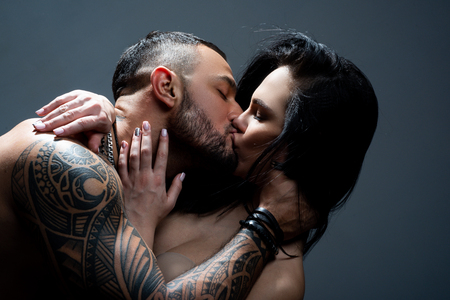 Passionate couple kissing. Romantic couple kissing. couple in love. love and romance. valentines day. Young lovers. i love you. kissing couple. desire and temptation. hot relationship