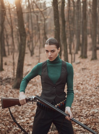 woman with weapon. Target shot. successful hunt. hunting sport. military fashion. achievements of goals. girl with rifle. chase hunting. Gun shop. female hunter in forest. Hunters walking in forest Stockfoto