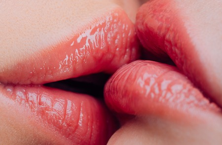 Lesbian kiss. Sensual wet female lips kissing. Lesbian pleasures. Oral pleasure. Couple girls kissing lips close up. Sensual touch kissing sexual activity. Hot foreplay. Lip care. Sex education Reklamní fotografie - 122036636