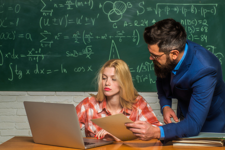 Teacher helping his students with math or mathematics on education class. Back to school. Teacher teaches a student. Team collaboration concept. Teacher. Stock Photo