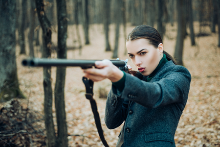 Hunting weapon gun or rifle. military fashion. achievements of goals. girl with rifle. chase hunting. Gun shop. woman with weapon. Target shot. female hunter in forest. successful hunt. hunting sport