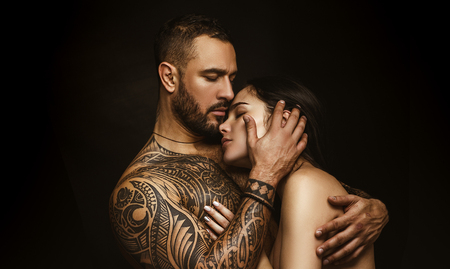 Love and desire. Latino man hugging adorable woman with love. Sensual couple in love. Erotic love of hispanic man and sexy woman Banque d'images