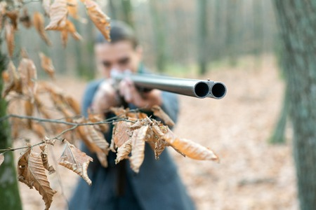 Looking at target. gun barrel. girl with rifle. chase hunting. Gun shop. military fashion. achievements of goals. successful hunt. hunting sport. woman with weapon. Target shot. hunter in forest