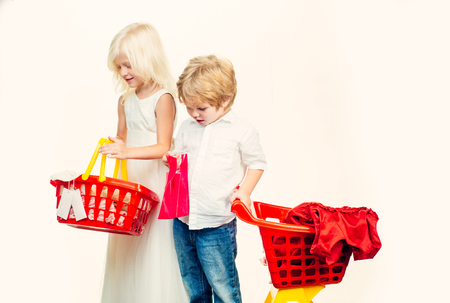 Couple kids hold plastic shopping basket toy. Kids store. Mall shopping. Buy with discount. Buy products. Play shop game. Cute buyer customer client hold shopping cart. Girl and boy children shopping Stock fotó