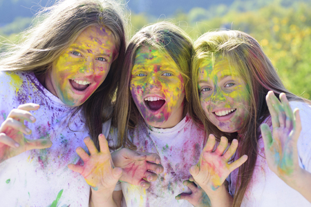 Emotional girls with happy mood with colorful dry colors. children with creative body art. Crazy hipster girls. Happy youth party. Optimist. Spring. colorful neon paint makeup. positive and cheerful
