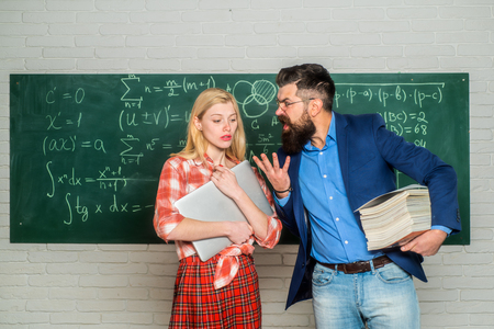 School mathematics lessons. University seminar. Tutor. Tutoring. Concentrated students following explanations of teacher in class. Students preparing for university exams. Education.
