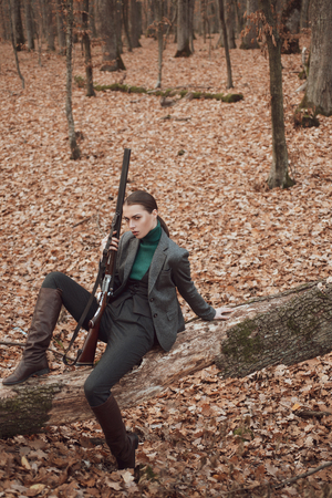 female with a gun. military fashion. achievements of goals. girl with rifle. chase hunting. Gun shop. female hunter in forest. woman with weapon. Target shot. successful hunt. hunting sport Stock Photo - 122567254