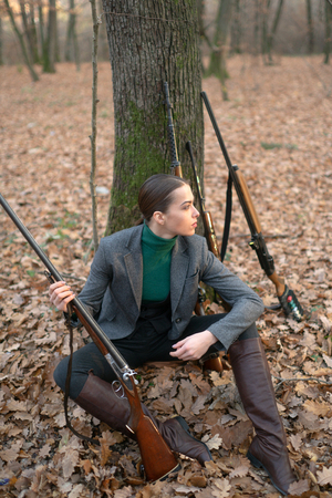 successful hunt. hunting sport. woman with weapon. Target shot. girl with rifle. chase hunting. Gun shop. female hunter in forest. military fashion. achievements of goals. Hunting season Stockfoto - 122569894
