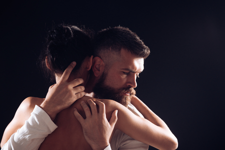 Connecting on a passionate level. Sensual couple in love. Couple of bearded man and sexy woman. Family couple hugging with tenderness. Erotic couple enjoying sexual experience, copy space