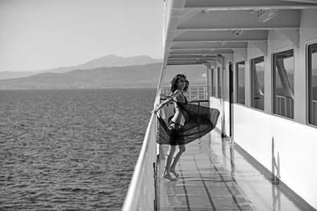 Sexy woman travel by sea and relax. Marine traveling and boat trip. Fashion and beauty look. Girl on ship deck in fashion swimsuit. Summer vacation and travel to ocean